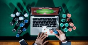 laptop casino, gambling chips and cards